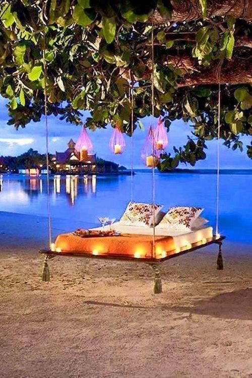 When lighting romantic beach-side hammock beds, be sure to use LED candles. #SafetyFirst