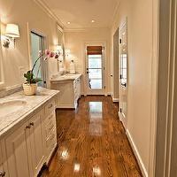 Neutral Bathroom - The Wills Company - bathrooms - overhead bathroom lighting, narrow bathrooms, long bathrooms, long master bathrooms, separate bath space, separate shower room, separate bath room, glossy white crown molding, bathroom crown molding, glossy white door moldings, bathroom door moldings, glossy white bathroom door moldings, bathroom hardwood floors, coffee stained bathroom floors, coffee stained bathroom wood floors, beveled mirror, white beveled mirrors, beveled bathroom…