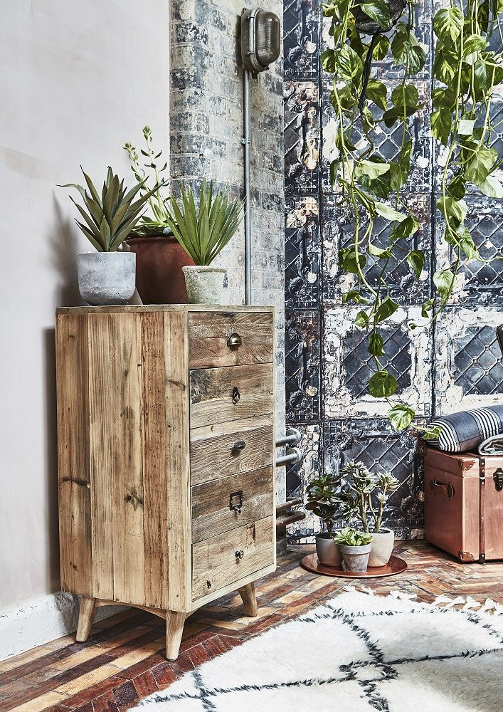 Fusing exposed materials, worn leather and industrial fixtures with a pared-back colour palette, the Reclaim Revolution trend embodies urban style at its best. Get the look with the Keeler 5 Drawer Chest made from reclaimed wood for a rustic look. Click to shop.
