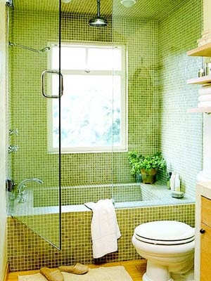 brilliant use of a small space.  I would have used all white or all turquiose tiles, but the use of glass and the tub-shower combination is fantastic.  They were even so thoughtful as to make the tub rim wide enough to also serve as a shower bench.