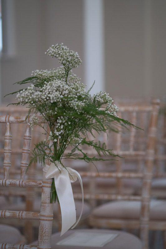 Wedding ceremony aisle chairs - ribbon tied asparagus fern and gypsophila - so pretty!