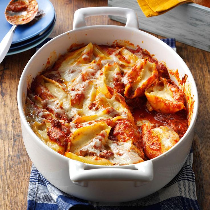 Three-Cheese Jumbo Shells Recipe -I love cooking, but I'm not into fancy gourmet foods. I think it's more challenging to make delicious, down-home foods like this beefy casserole with ingredients easily found in the refrigerator and on my pantry shelves. —Marjorie Carey, Alamosa, Colorado