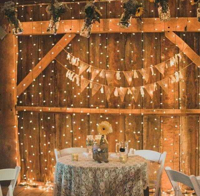 Rustic barn reception decorated with twinkle lights  Wedding Simple Rustic  Wedding