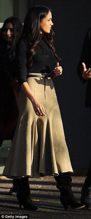 Meghan also showed off her camel skirt by British brand Joseph
