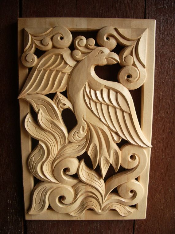 Woodcarving, Home Décor, Wood Art, Woodcraft, Woodworking, Wooden Phoenix, Wall Hanging, Wooden Gift, Handmade    I made this openwork woodcarving from linden wood with bright natural color. It is fully handmade and performed in Bulgarian native style. It represents fine carved Phoenix rising from the ashes. It will be very nice decoration for your home or wonderful present for a friend.    Size – 14,96 x 9,45″ / 38 x 24 cm.    Note that this item is made to order and it is not ready to be…