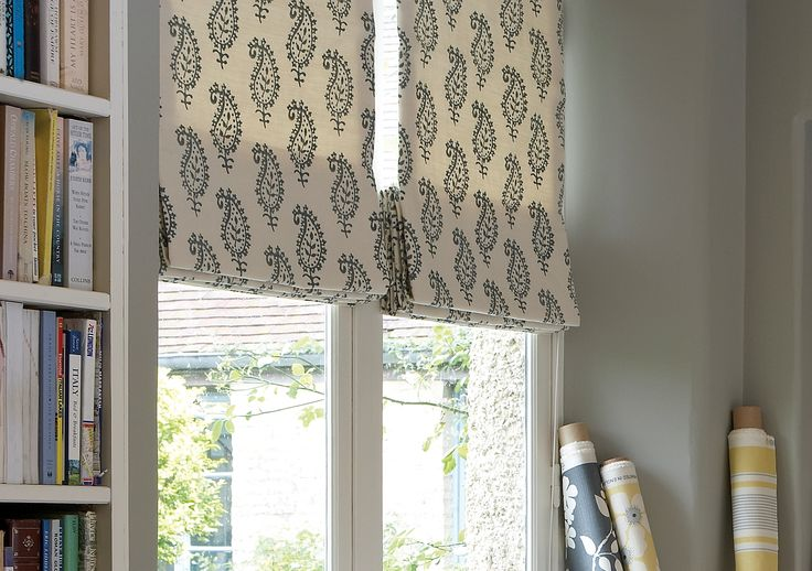Hand printed Roman Blind in Life and Eternity Detail Charcoal. Brighten up the room by adding a touch of buttercup yellow to the fabric.