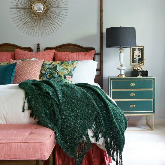 Out of date master bedroom gets a massive makeover in hunter green and coral to create a cozy retreat.