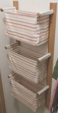 Pendurado na parede de armazenamento com três cestas de tecido IKEA