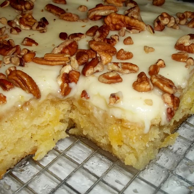 Easiest Pineapple Cake -- You spread the cream cheese frosting over it while it's still hot, so the frosting melts and seeps into the cake, making it a little gooey and dense.