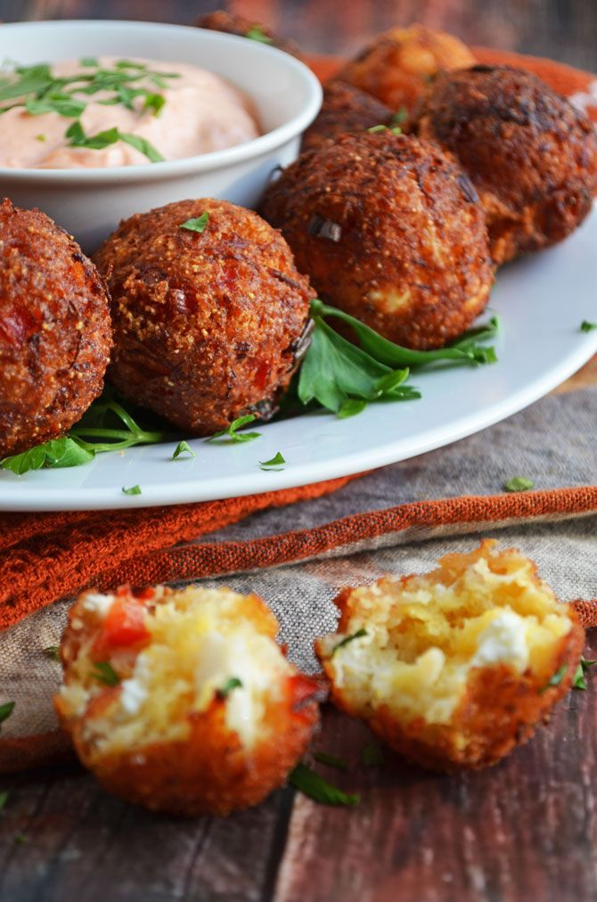 Cheesy Crab Poppers...cornbread brings out the sweetness of the crab and the addition of the bell peppers and cheese gives it all a great balance of flavors.  Add chopped jalapeno for a kick of spice and serve with favorite prepared remoulade sauce