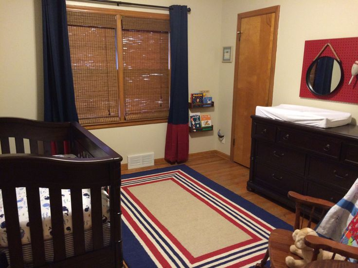 The book shelves are stained IKEA spice racks - $3.95/piece! Owen's nautical nursery is ready!