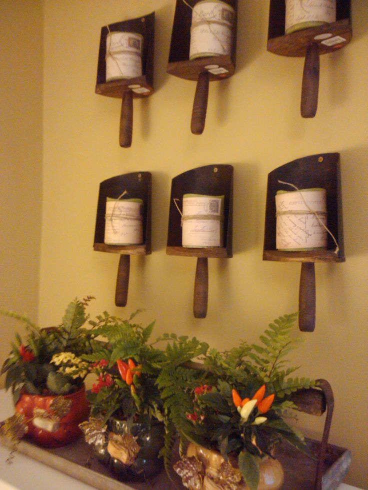 Old Grain Scoops..re-purposed into primitive wall mounted candle holders!!  Love that they wrapped the candles with twine.
