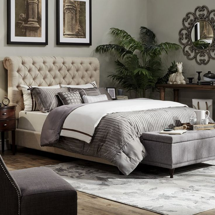 Top this stylish tufted bed with allwhite bedding for a