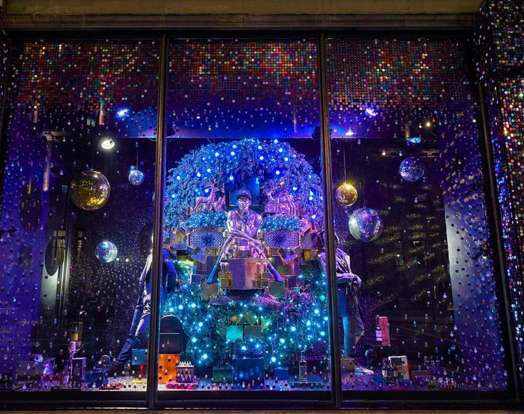 Image result for harvey nichols window display 2017 man in circle