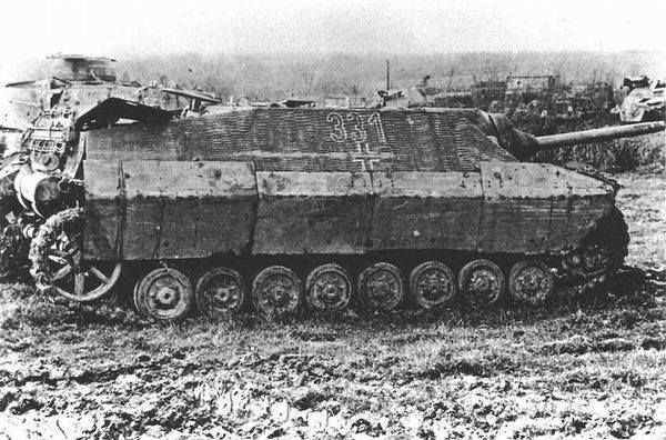 A Jagdpanzer 4 Ausf. F (L/48) with some armored panels made with salvaged materials by the crew for added protection