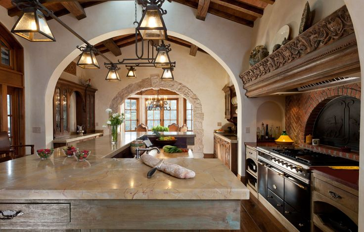 spanish colonial kitchens - A little dark, but love the light fixtures, the counter, and the ceiling/arch!