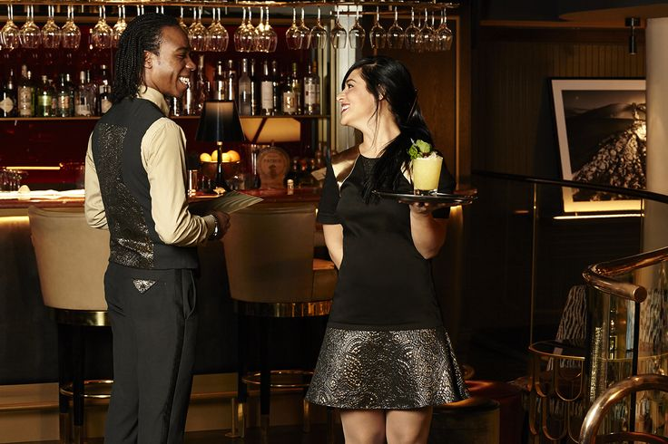 The waitress is ready to serve your drinks! Her Studio 104 uniform subtly reflects the stunning interior.