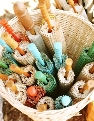 beach wedding parasols in a basket