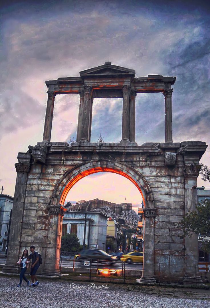 Hadrian's gate in Athens.....GREECE ,and rock of ACROPOLIS.....