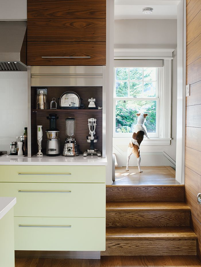 Dan Pacek and John Roynon of Leonia, New Jersey, expanded and renovated their tiny kitchen, integrating it more sensibly into their 1911 house while borrowing natural light from secondary sources, such as a window on the landing leading to the second floor.