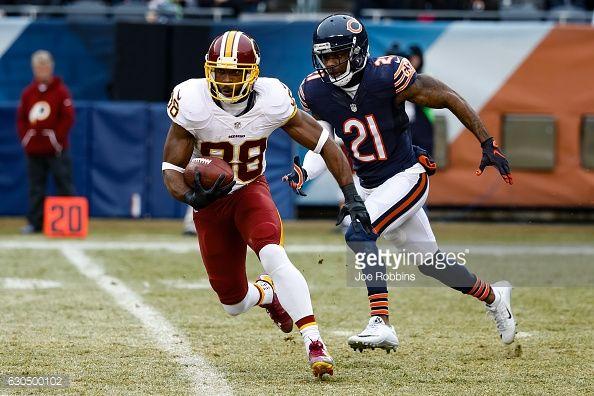 News Photo : Pierre Garcon of the Washington Redskins carries...