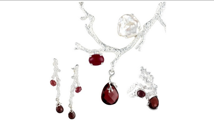 The Rowan Set is inspired by the mystical appeal of the rowan tree. Handcrafted from sterling silver, the set comprises a pendant, ring and a pair of earrings. Each piece is fashioned to look like a silver branch, adorned with an oval ruby and a faceted garnet, while the pendant also features a freshwater button pearl. Given an anti-tarnish coat to preserve its delicate beauty, this set has a regal elegance worthy of a princess