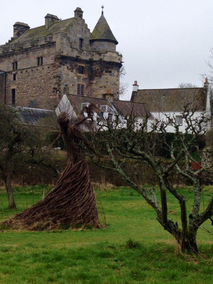Lady with a bird sculpture, Scotland