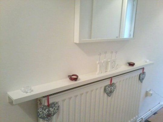 Upside down use of Ikea's ribba picture ledge on top of a radiator - 20 Ways to Use IKEA's RIBBA Picture Ledges All Over the House