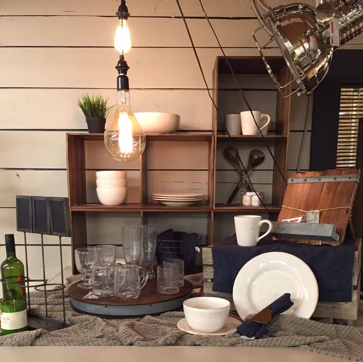 How pretty do these dishes look displayed in these stacking shelves!? And amazing bubble glassware on a wine barrel lazy susan!