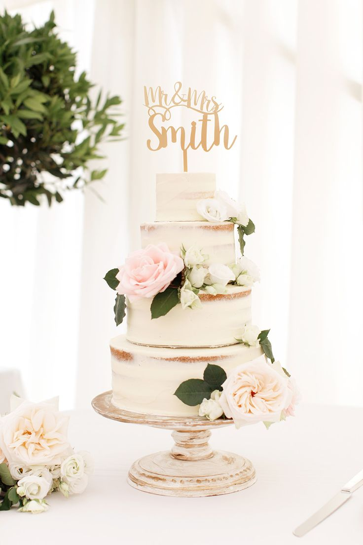 Semi Naked Wedding Cake with beautiful flowers and Mr. & Mrs. cake topper Photography by Rachel Rose Photographer