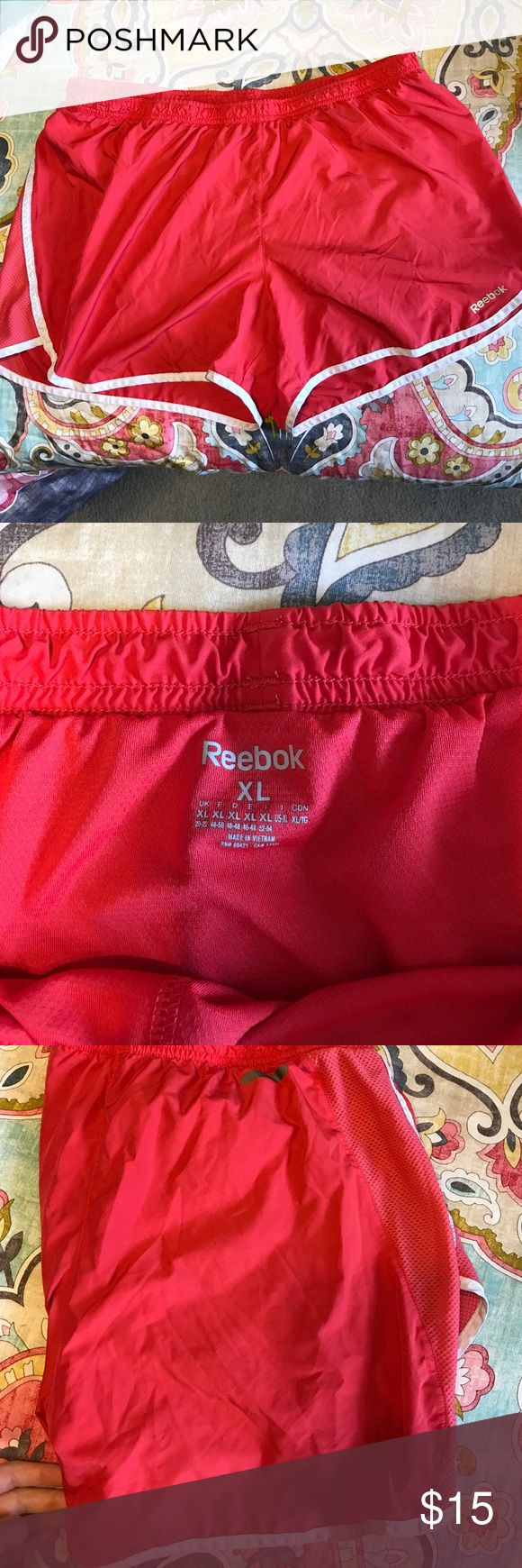 NWOT Reebok dri fit athletic running shorts coral Super comfy and soft, just too big for me. Similar look and feel to the Nike dri fit shorts, bundle to save more money. Smoke free home Nike Shorts
