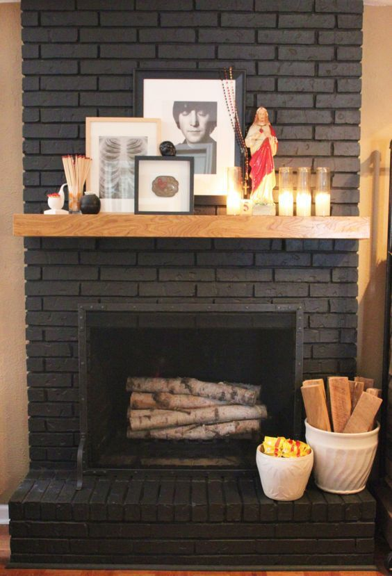 Brick fireplace painted a dark gray almost black with wood mantel and home decor by cavender diary boys