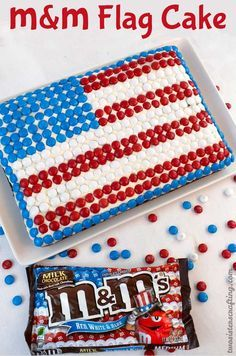 This M&M Flag Cake could not be easier to decorate and it is a great last minute dessert for a 4th of July party or a Memorial Day BBQ.  For more fun and patriotic 4th of July Food Ideas, follow us at www.pinterest.com...