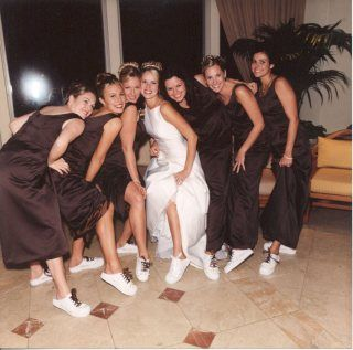 Bride and girls showing off their shoes