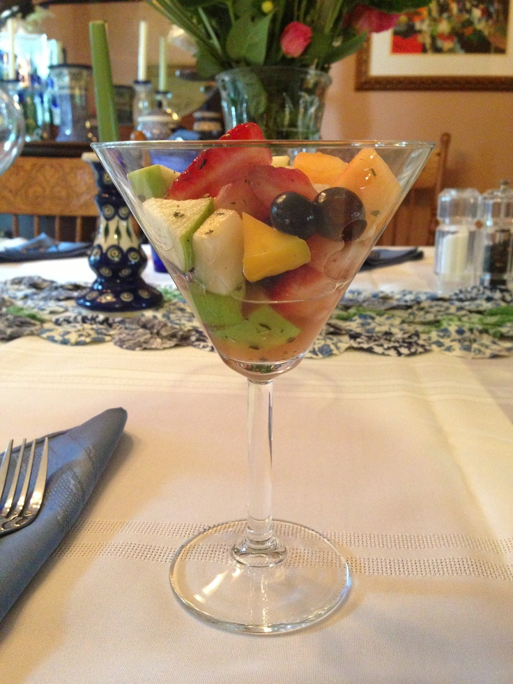 Bridal luncheon fruit salad... Mixed with honey and mint, served in a martini glass. So good!