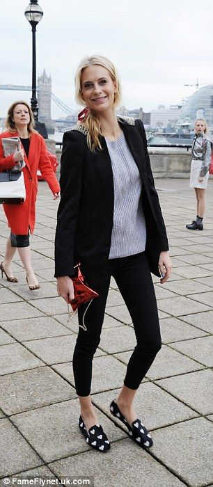 Poppy Delevingne attends the Anya Hindmarch fashion show held at London's Tate Modern Museum