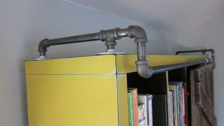Attaching sliding door hardware ikea hack bookshelves for Ikea barn door hardware