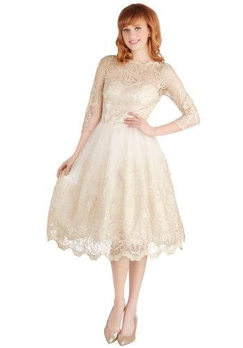 When you reach the waiting arm of your sweetie in your metallic pumps, strands of pearls, and this lace dress, you'll feel ready to dance the night away!