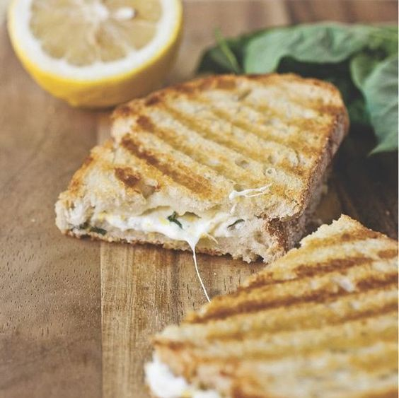 Lemon-Basil Grilled Cheese Panini - Lemon zest and fresh basil make these about the most fresh-tasting grilled cheese sandwiches you're going to find.
