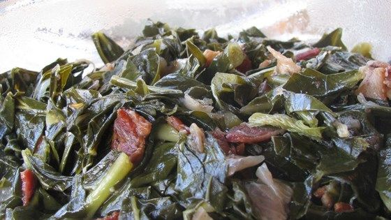If you like greens you will love this recipe.  The bacon and onions give them a wonderful flavor.  Add more red pepper for a little more spice.