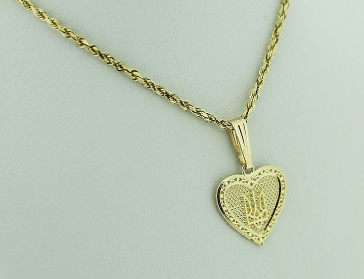 14kt gold heart-shaped tryzub pendant. Show off your Ukrainian pride with this beautiful, timeless piece.