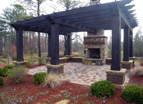 Pergula with stone floor and fireplace. It want this over my back patio. @bsloup209