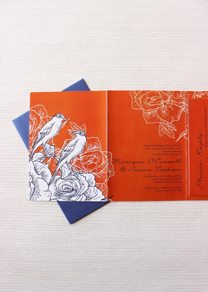 beautiful orange wedding invitation with navy blue birds perched on roses nz