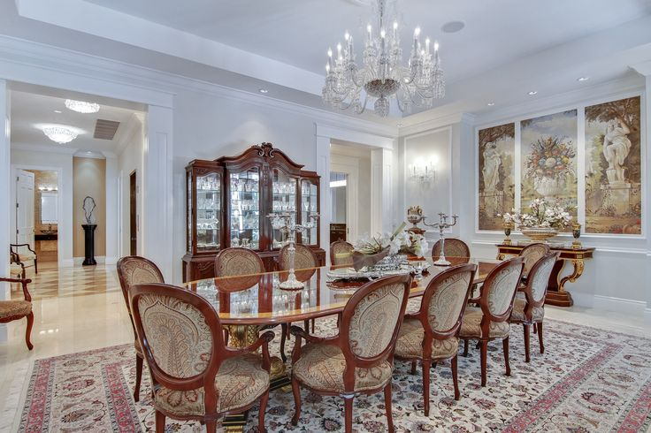 The formal dining room at Villa Dwora is nothing short of stunning; wth finishes such as a Baccarat crystal chandelier, wainscoting, coffered ceilings, & custom Italian hand painted murals, you'll always dine in style!  #SupremeAuction #LuxuryAuction #Miami #CoralGables #MiamiMansion #MiamiRealEstate #Florida #FloridaRealEstate #ResortStyle #Auction #KoiPond #MediterraneanMansion