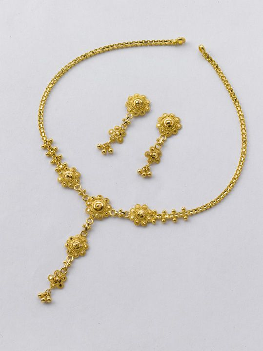 Necklace : 8 gm and price Rs.27,000/- Earrings : 4 gm and price Rs.13,300/-