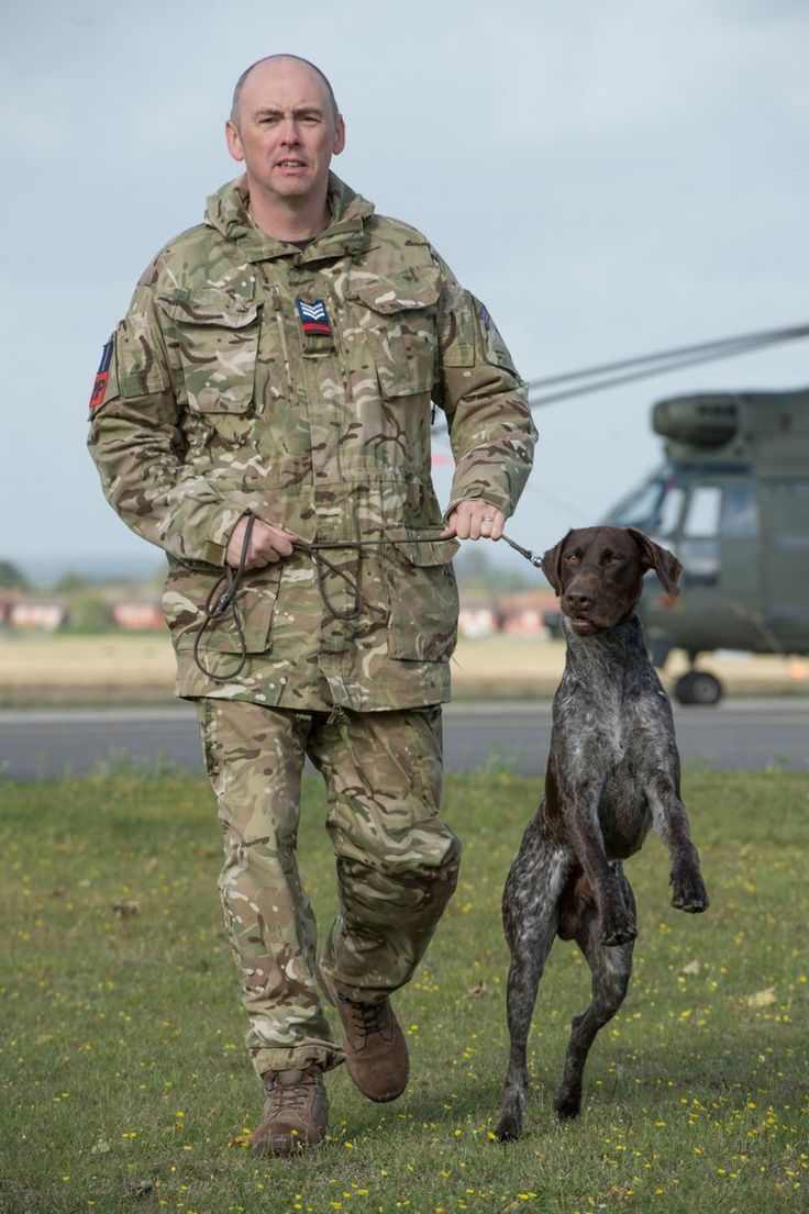 Sergeant Jonathan Tanner with Hertz, a mobile phone detection dog