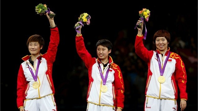 (L-R) Gold medallists Ding Ning, Guo Yue and Li Xiaoxia of China celebrate on the podium during the medal ceremony for the Women's Team Table Tennis on Day 11 of the London 2012 Olympic Games at ExCeL