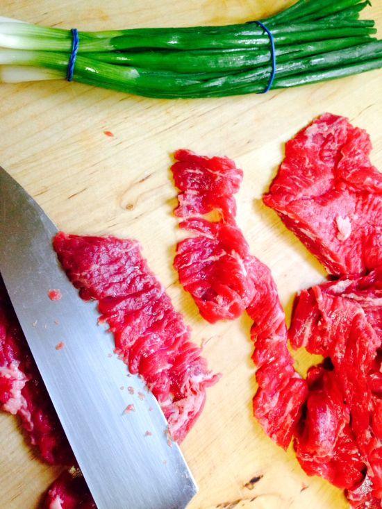 attack phase mongolian beef.  flank steak, green onion, ginger, garlic, soy sauce, brown sugar sweetener, corn starch