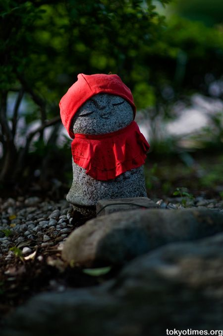 Jizō statues are sometimes accompanied by a little pile of stones and pebbles, put there by people in the hope that it would shorten the time children have to suffer in the underworld. The statues can sometimes be seen wearing tiny children's clothing or bibs, or with toys, put there by grieving parents to help their lost ones and hoping that Jizō would specially protect them. Sometimes the offerings are put there by parents to thank Jizō for saving their children from a serious illness.