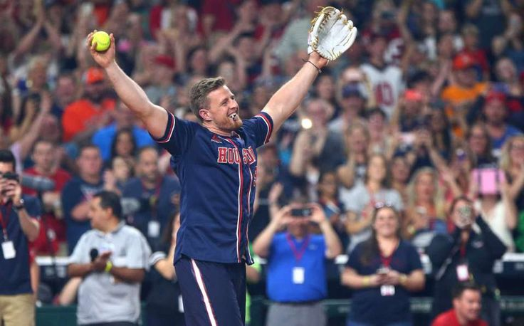 Houston Texans defensive end J.J. Watt (99) celebrates after former First Lady Barbara Bush threw the opening pitch to the 4th annual J. J. Watt Charity Classic at Minute Maid Park Saturday, May 14, 2016, in Houston.